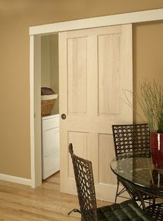 Wall Mount Door Hardware....like a barn door, but used with regular doors. Click to view other installations. by connie