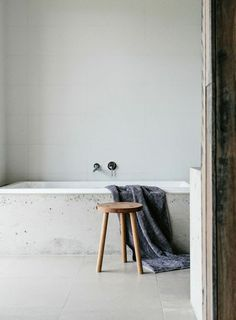 Concrete bath tub and wooden stool