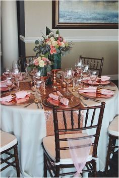 Beautiful tablescape with rose gold sequin runners, copper chargers, and rose quartz colored napkins. The floral arrangements tie each shade in to make for a beautiful blend of warm colors!