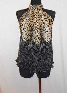 Kupuj mé předměty na #vinted http://www.vinted.cz/damske-obleceni/topy-and-tank-topy-bez-rukavu/15133194-plisovany-top-ke-krku-se-zvirecim-vzorem
