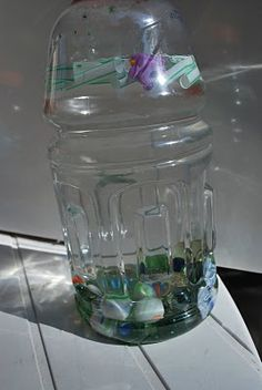 Sink or Float Bottle  Place items that are heavy enough to sink in water, like marbles, in an empty plastic bottle.  Place items in the bottle that will float, like straws that have been cut into little pieces.  Fill the bottle with water. Seal shut with hot glue.  Let children perdict what will happen and then shake the bottle vertically, horizontally and upside-down. Children should be able to see which items float to the surface and which items sink.