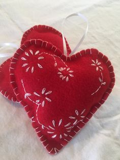 Two Scandinavian hand embroidered red and white heart by MaryEGuad