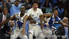 UNC players (left to right) guard Kenny Williams (24), forward Theo Pinson (1), forward Justin Jackson (44) and guard Nate Britt (0) react after reserve player Kanler Coker (13) scores near game's end against Texas Southern at the NCAA tournament Friday, March 17, 2017, at the Bon Secours Wellness Arena in Greenville, S.C. UNC won the game 103-64