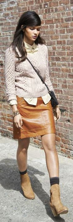 Love this outfit!  Caramel leather skirt and beige sweater. Women's street style urban fashion clothing outfit