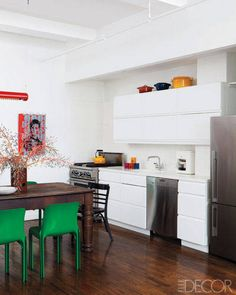 The refrigerator is by Fisher & Paykel, the dishwasher is by Miele, and the sink fittings are by IKEA; the countertops are Corian.   - ELLEDecor.com