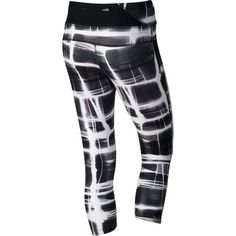 The Nike Women's Twisty Print Crop Pant is made of polyester and spandex and features Dri-FIT fabric technology.