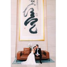 nice vancouver wedding Tradition meets modern at the @shangrila_van where a young couple is captured beneath a towering Chinese brush calligraphy art piece in the grand lobby. #chinesewedding #traditionmeetsmodern #chineseculture #shangrilavancouver #luxuryweddings #besthotels #vancouver #asianwedding #BCwedding #westcoast : @shangrila_van by @prized_magazine  #vancouverwedding #vancouverweddingstationery #vancouverwedding