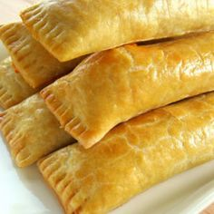 Guyanese Cheese Rolls - Every weekend my family made our routine trip to Liberty Avenue in Queens, NY to purchase our Guyanese baked goods for the week. Guyana Food, Cheese Roll Recipe, Tandoori Masala, Cheese Straws, Indian Food Recipes, Ethnic Recipes, Haitian Recipes, Filipino Recipes, Cheese Rolling