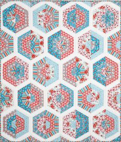 What a beautiful throw quilt pattern! Mary McGuire's choice of fabrics and fabric arrangement in Goodness Gracious is spot on - This quilt has interest and appeal. It's a vintage-inspired quilt with a fresh modern look.