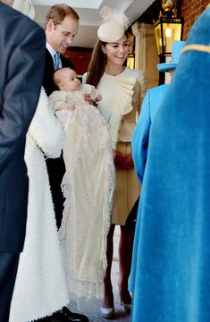 Prince William and Kate Middleton (in Alexander McQueen) attend Prince George's christening on October 23, 2013 in London