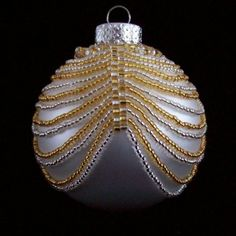 Christmas Ornament Silver and Gold Cover: Beading Tutorial Beaded Ornament Covers, Beaded Ornaments, Handmade Ornaments, Ball Ornaments, Handmade Christmas, Crochet Christmas Ornaments, Holiday Ornaments, Felt Christmas, Christmas Crafts