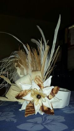 Tahitian side headpiece with handmade tapa cloth flower, burlap, niau, feathers, hau