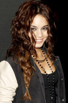 Vanessa Hudgens makes the most of her gorgeous curly hair by letting a lot of strands fall out of her mermaid braid. It's an unconventional approach on the braid trend, but with her natural sexy waves,