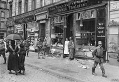 A Berlin butcher's shop looted in a food riot, 1919. The blockade of Germany was maintained during the period between the armistice and the signing of the Treaty of Versailles in June 1919. This caused huge resentment in Germany. Q 110881