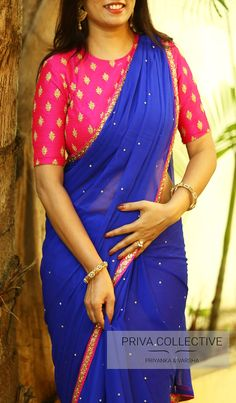 PV 3543 : Royal blue and PinkPrice : Rs 4450 Bring in the season with style. Royal blue stone studded chiffon finished with pink borderUnstitched blouse piece - Pink bhutti raw silk blouse piece as shown in the pictureFor Order 08 November 2017 Cotton Saree Blouse Designs, Fancy Blouse Designs, Blouse Patterns, Fancy Sarees, Party Wear Sarees, Hyderabad, Saree Trends, Saree Models, Stylish Sarees