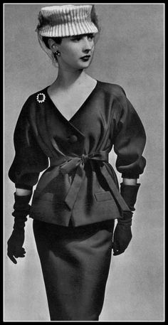 Renée Breton in navy blue alpaca two-piece, top tied with same-fabric belt, white toque with navy voilette, by Christian Dior, photo by Georges Saad, 1956