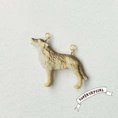 Wolf Charm. $8.50, via Etsy.