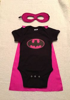 Batgirl Superhero Baby Onesie with Detachable Satin Cape and Reversible Mask, Apparel or Costume. ($29.00, via Etsy) this is the best thing i've ever seen!!!!!