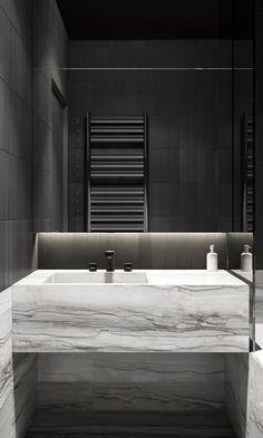 Dark bathroom with marble sink