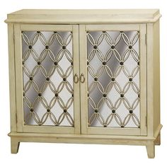 Display a vase of fresh blooms in your foyer or stow table linens in the dining room with this weathered beige cabinet, showcasing 2 mirrored doors with latt...
