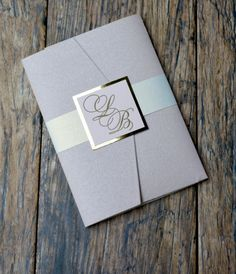 Custom blush glitter pocket folder with letterpress monogram square. This pink and gold letterpress invitation is the perfect balance of romantic and formal. Stationery by Lucky Invitations.
