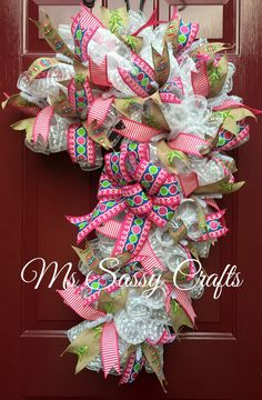 Candy Cane Wreath - Christmas Candy Wreath - Christmas Candy Cane Wreath - Winter Wreath - Christmas Deco Mesh Wreath - Christmas Wreath by MsSassyCrafts on Etsy https://www.etsy.com/listing/258529725/candy-cane-wreath-christmas-candy-wreath