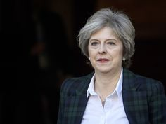 PM insists Government remains 'committed to an NHS that is free at the point of use'