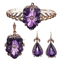 Amethyst, diamond and gold parure, comprising of a bracelet, a pendant and a pair of earrings.