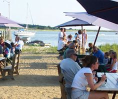 """Mac's on the Pier. an Honest-to-goodness clam shack. Right on Wellfleet harbor, next to our original fish market. Come in and """"see em swim."""" Cape Cod."""