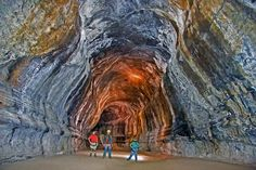 Oregon - the caves in central Oregon are lava tubes (The lava on the outside hardens while the molten interior continues to flow elsewhere, leaving a hollow tube.)