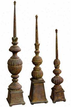 Sculptural finials-add height to mantel