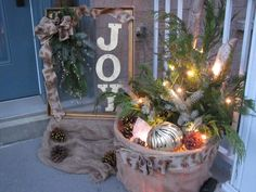 Christmas porch decor made using a re-purposed picture frame, fresh greenery, and a bushel basket wrapped in burlap Christmas Porch, Vintage Christmas, Chicken Wire Crafts, Bushel Baskets, Porch Decorating, Greenery, Picture Frames, Burlap, Table Decorations
