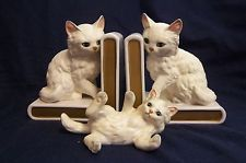 "Vintage 3 piece set of Lefton Cat bookends & playful kitten figurine-JAPAN Bookends are marked with the number ""H 518"" and are 5.5"" tall, 5"" wide and 3"" deep. Kitten figurine is marked ""H 1513"" and is 5.5"" long, 2.5"" tall and 2"" wide. Kitten still has his original red Lefton sticker that reads ""Lefton Trademark Exclusives JAPAN"""