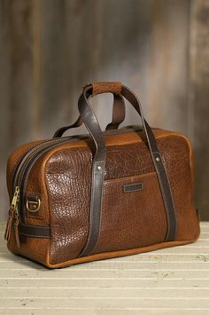 Our Bison Weekender is a showpiece duffel bag with the luxurious pebbled texture. Our Bison Weekender is a showpiece duffel bag with the luxurious pebbled texture of American bison leather. Leather Wallet Pattern, Leather Card Wallet, Mens Travel Bag, Travel Bags, Duffel Bag, Fashion Bags, Leather Men, Leather Shoulder Bag, American Bison