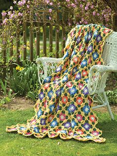Sunny Day Flowers Throw By Diane Poellot - Free Crochet Pattern - See http://www.crochet-world.com/newsletters/images/2015/40201315-07/SunnyDayFlowers.pdf For PDF Pattern - (crochet-world)