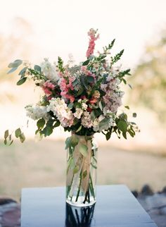 Rustic #centerpiece with green, pink, and white flowers by Michael Daigian Design.