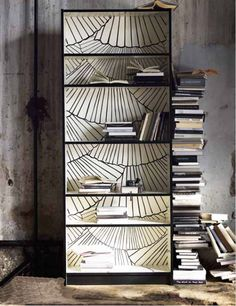 The IKEA BILLY bookcase gets a new look this spring with an open books motif inspired by fanned pages of open books. (DIY inspiration)