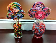Candy centerpieces - could match to colour scheme. Cost might be recovered