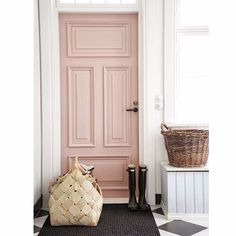 What's not to love about this gorgeously blush pink door with hints of monochrome on the beautiful floor!