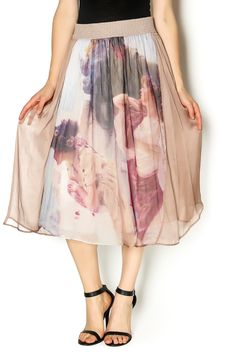 This vintage inspired silk blend midi skirt is nothing short of magical. It is beautifully flowy with a wide elastic waste band for amazing comfort. Wear it with a tucked in simple white t-shirt or tank and your favorite strappy heels.   Silk Midi Skirt by Aratta. Clothing - Skirts - Midi Clothing - Skirts - Statement Montana