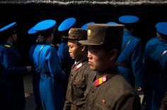 North Korean soldiers, foreground, and North Korean traffic police, background, tour the birthplace of Kim Il Sung to pay their respects at Mangyongdae, North Korea, on April 13, 2011.