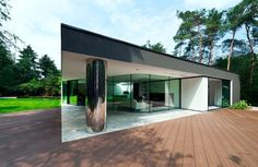 Dutch architecture firm 123DV recently completed this modern villa, called Villa Veth, in Hattem, Netherlands.