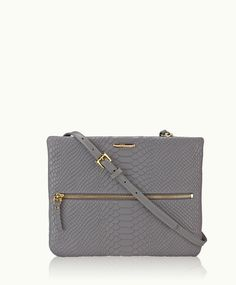 Casual yet practical, feminine and modern. Includes detachable strap, zip-top closure and exterior zip pocket.