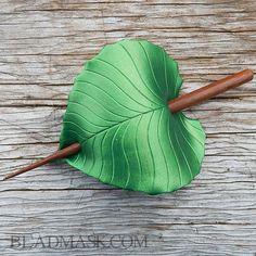 This sculpted leather barrette is loosely modeled after the cheerful little birch leaves in my area. Hand cut and shaped from high quality tooling