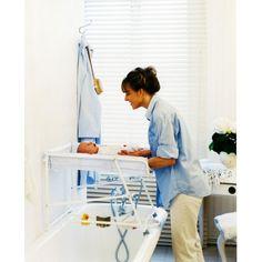 table langer et baignoire adaptable sur une baignoire. Black Bedroom Furniture Sets. Home Design Ideas