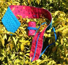 Wrist Wraps in multi colour musical notes in hot pink with blue lining and laces.  Great for CrossFit, pole dancing and weight lifting.
