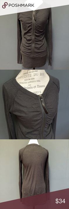 Mystree Cashmere Grey Ruched Zip Up Tunic Shirt L Mystree lightweight and very soft long grey ruched tunic with rhinestone on the zipper. Casual-adorable. :) Size Large. 41% Rayon. 50% Acrylic. 9% Cashmere.  Save 15% and shipping when you bundle! I have 200+ awesome clothing and accessories in my closet!  Tags: Anthropologie, free people, shirt, hoodie, long sleeve, winter sweater, soft, ribbed Henley, boho, Gypsy mystree Tops Tees - Long Sleeve