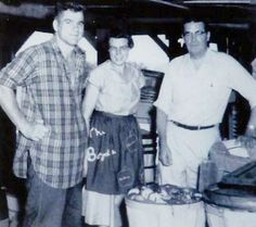 Pictured (L-R):  Boyd's International 4-H Youth Exchange student from Finland in 1956, Vivian Corzine Boyd, Mr. Glover; U of I Extension Farm Advisor in Union County.