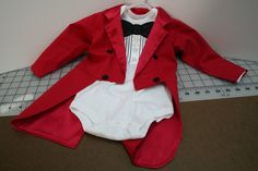 OMG!!!Oliver would be so cute in this with a top hat if he would wear it little ring leader!!