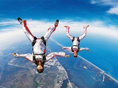 Google Image Result for http://www.sportsdesktopwallpaper.net/backgrounds/skydiving/upside_couple_appearing_to_be_skydiving.jpg